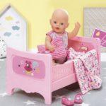 Игрушки для девочек: покупка кроватки для кукол
